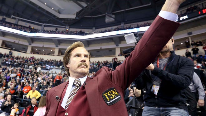 Will Ferrell, in character as Ron Burgundy, salutes the crowd at the Roar of the Rings Canadian Olympic Curling Trials, one of his many in character appearances.