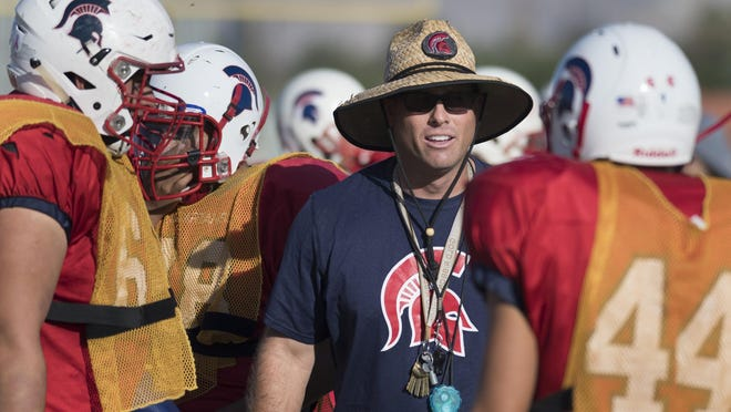 Strathmore head football coach Jeromy Blackwell guides his players through a portion of practice as the Spartans prepared for their game against Woodlake on Oct. 7.