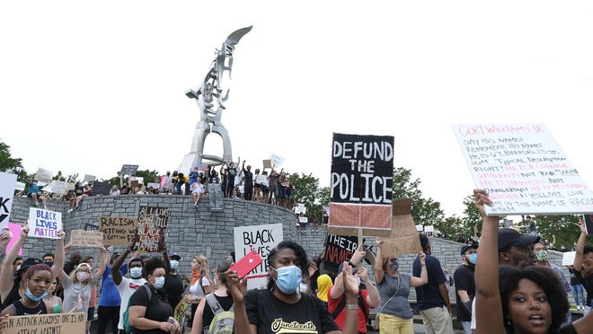In this June 7 photo, protesters gather for a peaceful demonstration at Springfield Park on Reynolds Street in Augusta.