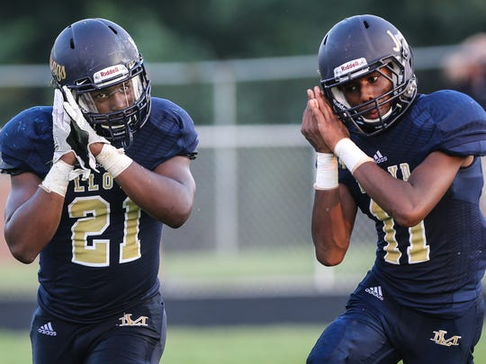 Justin Durham and Jamorrow Dawson celebrate Durham's third touchdown of the first half during their game with Walton-Verona at Lloyd Friday, August 19, 2016.