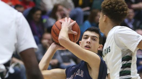 Byram Hills junior Skylar Sinon is pictured during his team's 50-48 loss to Elmont in the Class A state semifinals at the Glens Falls Civic Center on March 12, 2016.