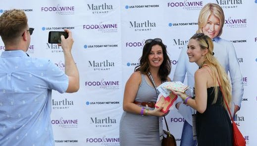 Attendees pose with a cardboard cutout of Martha Stewart during  a culinary festival in Detroit in September. Stewart  will appear in person to present a cooking demonstration and more when the Ventura County Star Food & Wine Experience takes place Oct. 1 in Ventura.