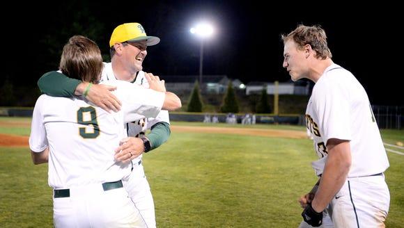 Reynolds' head coach Bryan Craig celebrates with Jimmy