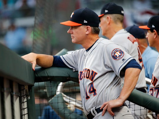 Houston Astros manager A.J. Hinch (14) watches from the dugout during the first inning of a baseball game against the Atlanta Braves Wednesday, July 5, 2017, in Atlanta. (AP Photo/John Bazemore)