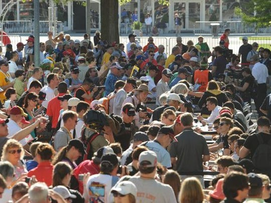 Race fans are shown packing the Pagaoda Plaza at the Indianapolis Motor Speedway on Saturday, May 24, 2014, for the final autograph session with drivers. A 25-year-old Kokomo man was killed early this morning in a fatal shooting in a parking lot near the racetrack.