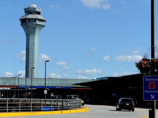 The air traffic control tower at Chicago's O'Hare airport is seen in 2013.