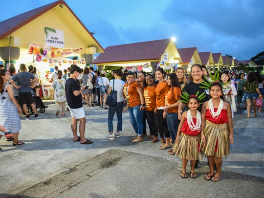 Island residents, visiting tourists and others gather