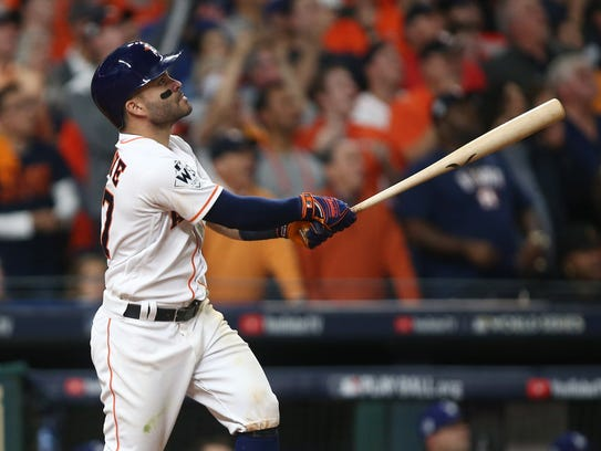 Jose Altuve hits a three-run home run in Game 5 of