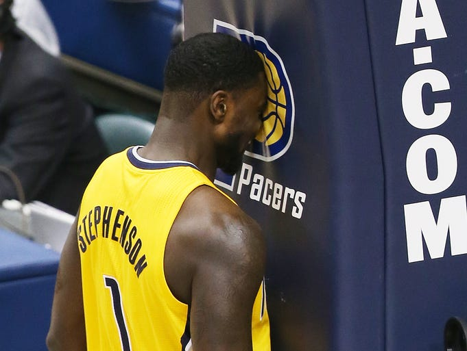 Pacer Lance Stephenson knocks his head against the goal after a big basket during the third quarter. The Indiana Pacers hosted the Miami Heat in game two of the Eastern Conference Finals at Bankers Life Fieldhouse Tuesday, May 20, 2014.