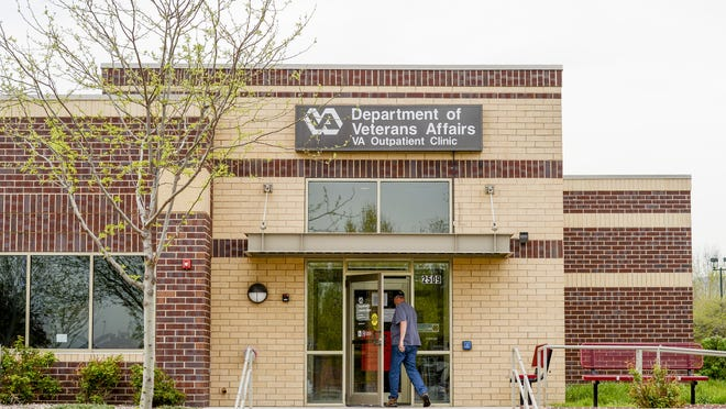 A man enters the Department of Veterans Affairs Outpatient Clinic in Fort Collins in this May 5, 2014, file photo.