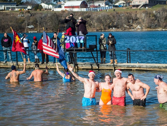 Hundreds braved the cold waters at Willow Springs Park