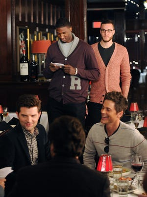 """Roy Hibbert looks over his lines during a 2012 visit from """"Parks and Recreation"""" to St. Elmo Steak House. Clockwise from upper right are former Pacer Miles Plumlee, Rob Lowe and Adam Scott."""