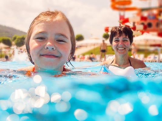 Mother and daughter having fun in pool