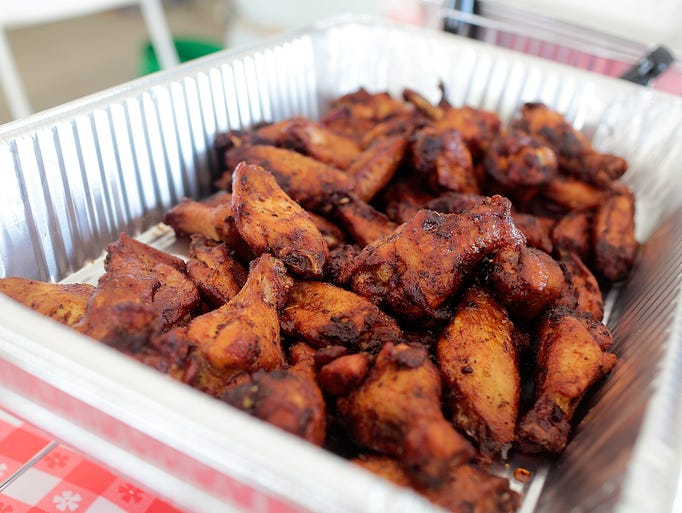 One of many trays of wings under the Jethro's BBQ tent