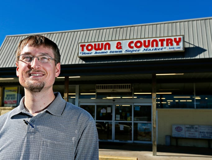 Devin Cooper, manager of Town & Country Supermarket