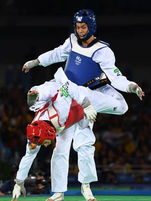 Taiwan's Liu Wei-Ting, right, got a leg up on Moldova's Aaron Cook, who was hoping to make a statement to Britain.
