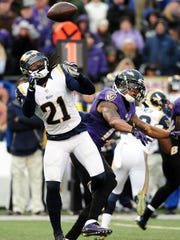 Nov 22, 2015; Baltimore, MD, USA; St. Louis Rams cornerback Janoris Jenkins (21) deflects the pass intended for Baltimore Ravens wide receiver Chris Givens (13) in the fourth quarter at M&T Bank Stadium. The Ravens won 16-13. Mandatory Credit: Evan Habeeb-USA TODAY Sports