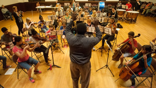 Conductor Kenneth Bean guides a rehearsal of Symphony in C's new Youth Orchestra, which is geared to students between 10 and 18.