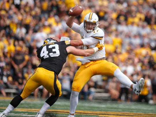 Wyoming quarterback Josh Allen tries to escape from
