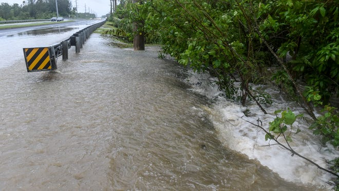 Motorists navigate heavy flooding on northbound Marine Corps Drive near the Polaris Point Intersection in Piti on Aug. 15 as Tropical Storm Goni approaches the Marianas Islands.
