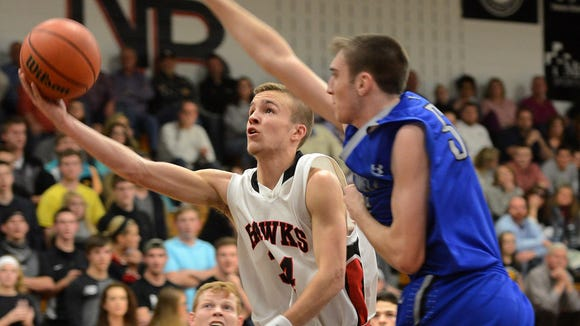 North Buncombe's Daniel Burchette, left, has committed to play college basketball for North Greenville (S.C.).