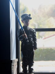 """Ethan Lee wears a """"Star Wars"""" costume at the Camarillo Library on Saturday."""