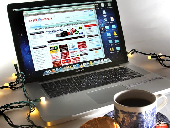 The FruGal takes on Cyber Monday in her column for IndyLiving 11/25. This is a photo illustration: laptop open to  webpage that she is recommending, cup of tea, bagel and cream cheese, pencil, notepad -- making it look like a person like FruGal is sitting at her kitchen table, ordering holiday gifts online. This will be a quick turnaround.  (FRank Espich/The Star)