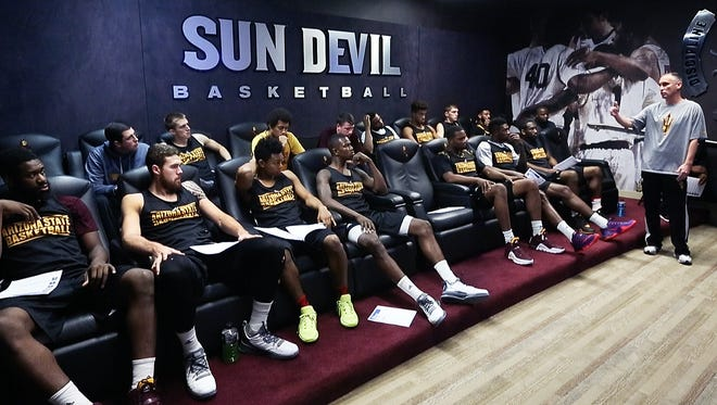 ASU men's basketball coach Bobby Hurley right, speaks to the players in the film room before practice at the Weatherup Center, Tuesday, December 1, 2015.