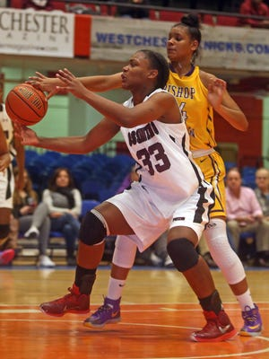 Ossining's Jalay Knowles is defended by Bishop Loughlin's Zaria Dorsey in the Slam Dunk Tournament championship game Monday at Westchester County Center in White Plains. Ossining defeated Bishop Loughlin 77-64. Knowles led all scorers with 36 points.
