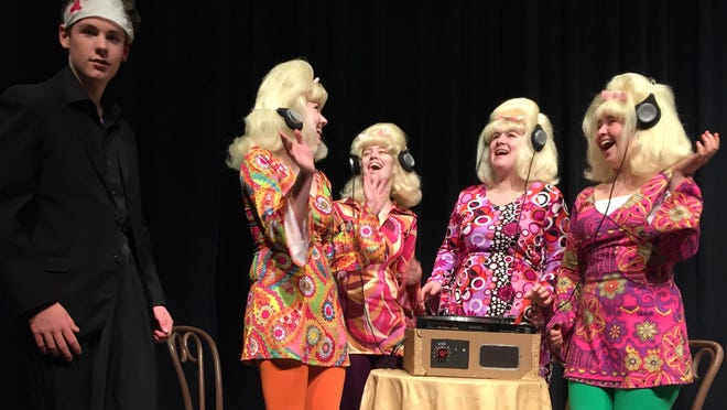 KAOS henchman Garth, left, played by Clancy Talbot, is holding four blondes captive as part of an evil KAOS plot. Garth entertains the blondes by playing them Beatles tunes during their captivity. Blondes are, from left, Hannah Hunt, Jane Lindsley, Katherine Mathon and Kianna Ayer.