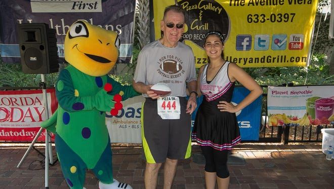 Gerry Fahey gets his photo taken after last year's I Run for Pizza 5K in Viera.