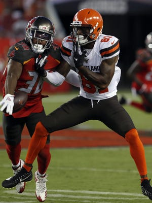 Tampa Bay Buccaneers cornerback M.J. Stewart Jr. knocks a pass away from  Browns wide receiver Rashard Higgins during a preseason game in August.