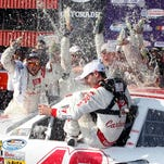 Kyle Larson gets drenched by his team after his win in the Nationwide Series race Saturday in Fontana, Calif.