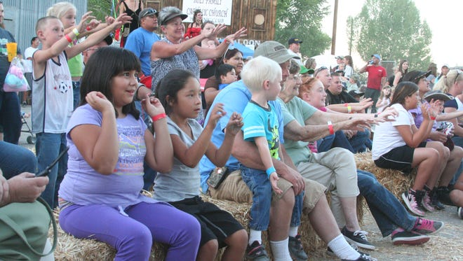 Good times, such as these people are having during a magic show at the 2013 Lyon County Fair and Rodeo, are sure to be had at the 2014 Fair and Rodeo that starts next week.