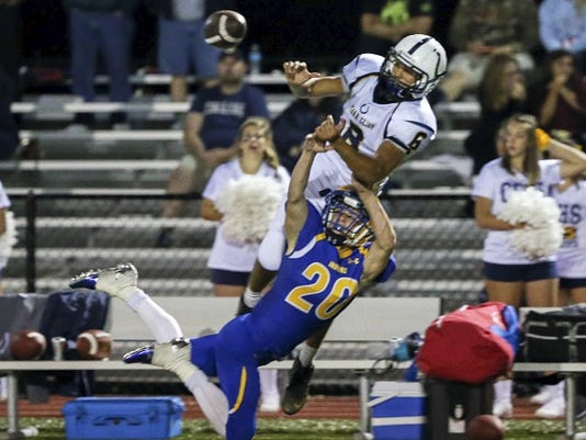 Jake Wertz of Waynesboro (20) defends a pass intended for Mike Viti of Cedar Cliff during the Colts' 55-32 win Friday night.