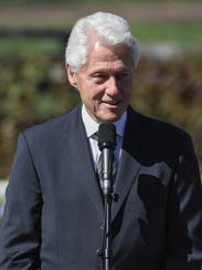 Former President Bill Clinton speaks after paying his