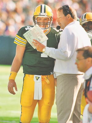 Brett Favre gets instructions from Packers coach Mike Holmgren during a Sept. 20, 1992, game vs. the Bengals.