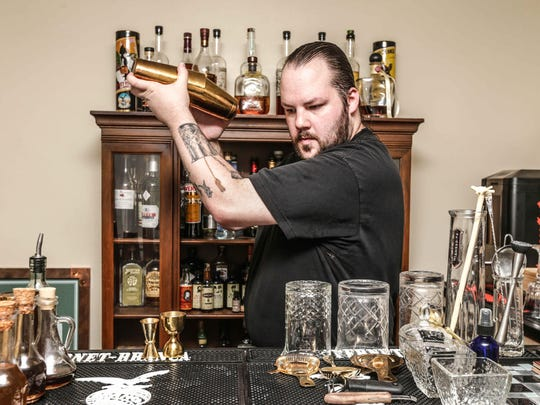 Steve Simon, Bar Manager at Broad Ripple Tavern, and future Beverage Director for Marrow in Fountain Square, mixes up a drink behind his home bar.