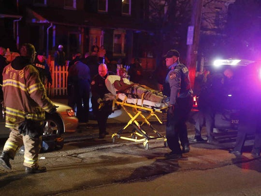 Emergency workers use a stretcher to bring a shooting