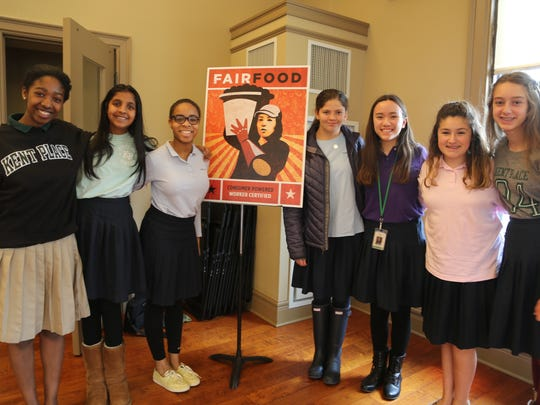 Kent Place Middle School students (from left) Lily Roberts of South Orange, Tarika Bansal of Short Hills, Madison Hobbs of South Orange, Brianna Moglianesi of Warren, Anna Hogarth of Summit, Amy Sales of New Providence and Jillian Sher of Summit pose with posters from the school's recent Fair Food program.