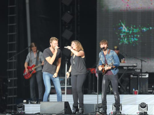 Lady Antebellum performs on stage during a free beach concert in Atlantic City in August 2014., N.J.