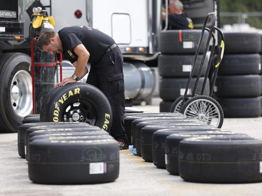 Tires are prepared at Road America Friday ahead of NASCAR Xfinity Series practice. The series races at the track Saturday.