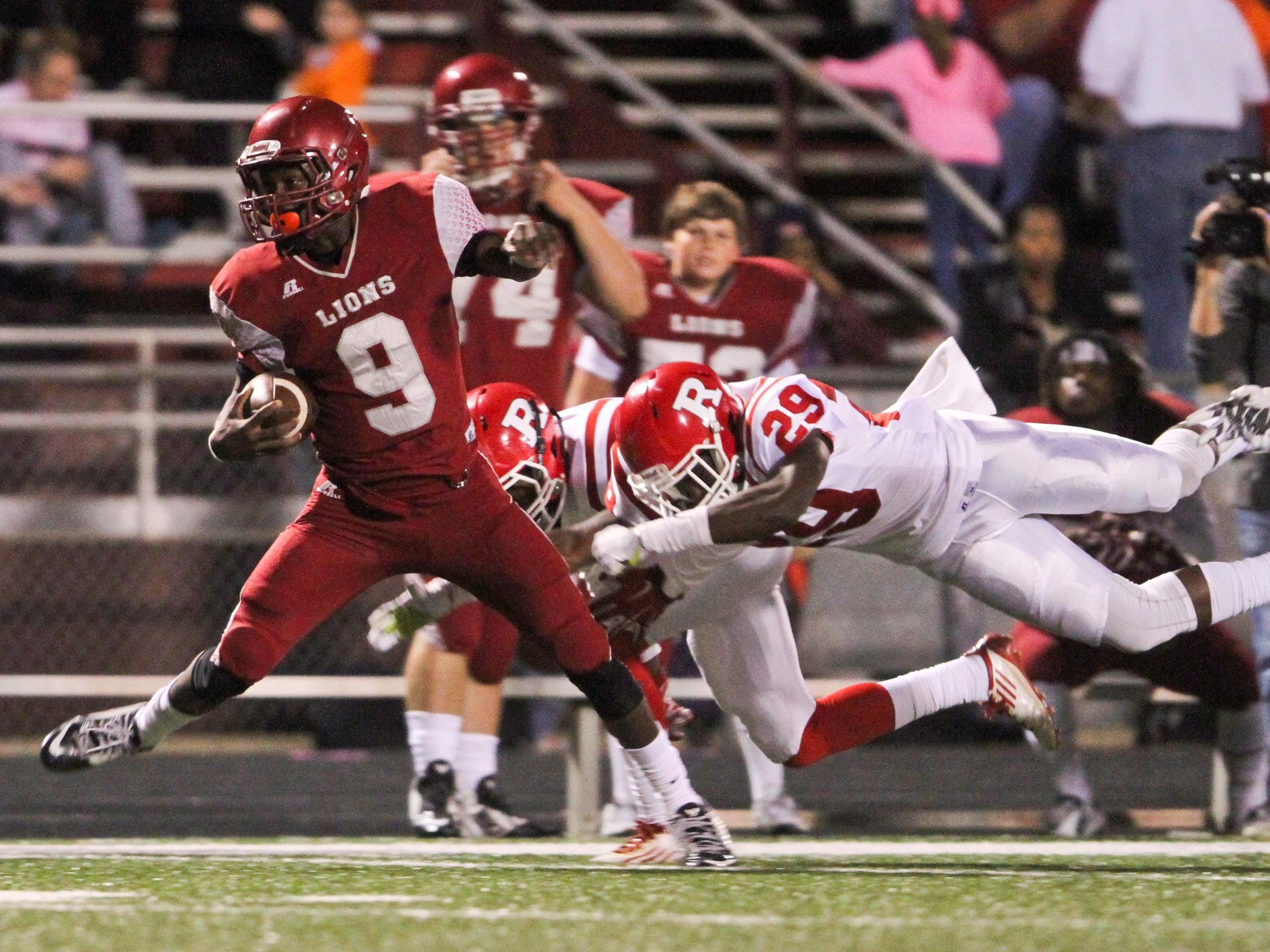 Ouachita Lion Devion Warren (9) outruns two Bearcat defenders and sprints toward the goal line for a touchdown. Emerald McIntyre/The News-Star