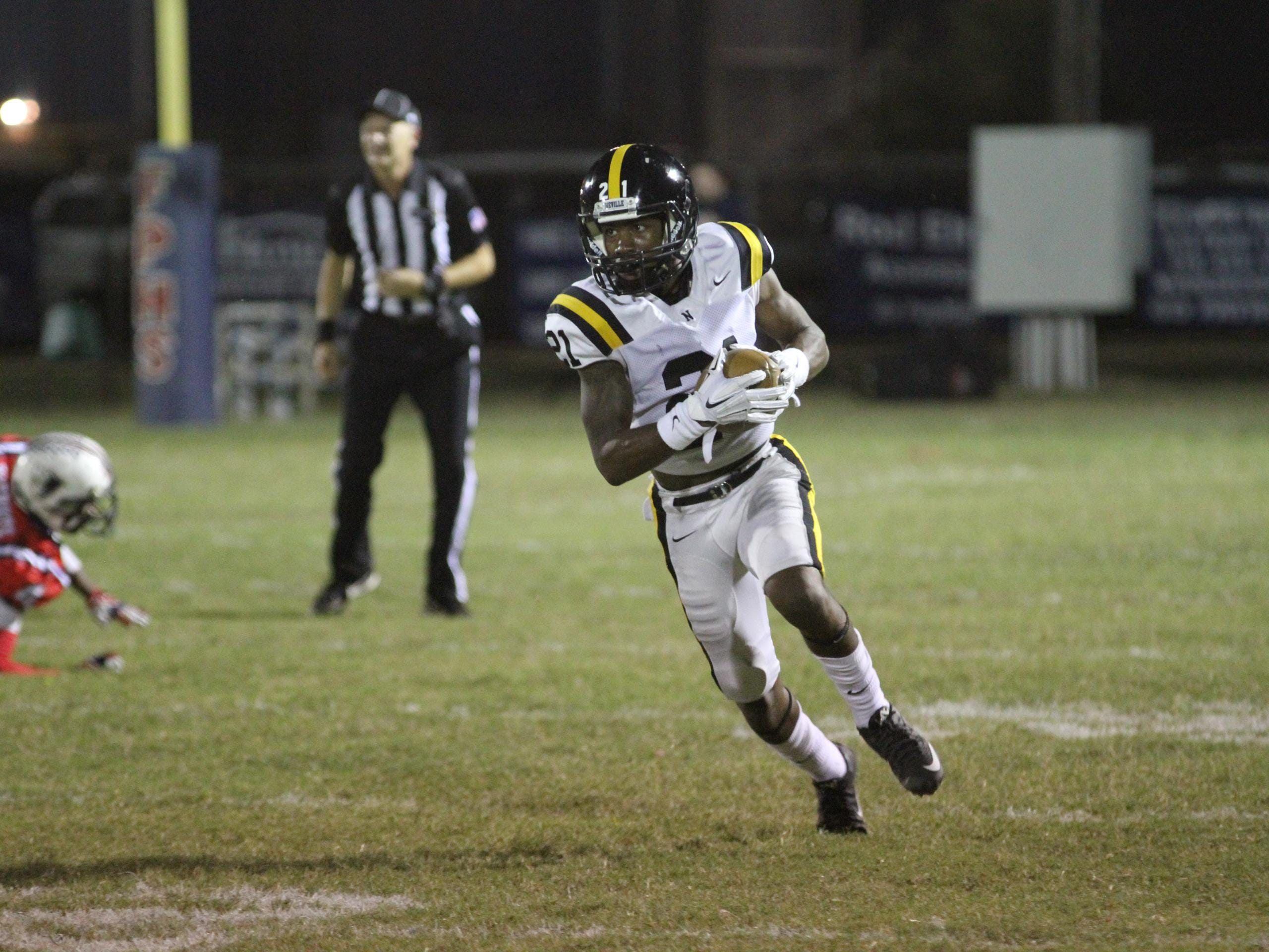 Neville's Corey Straughter (21) gets some yards for the Tigers in first half action against the Franklin Parish Patriots Thursday night in Winnsboro.