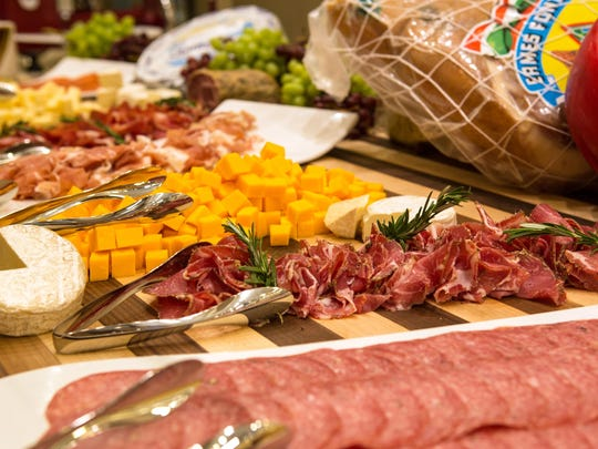 The new charcuterie section at Toucan Charlie's Buffet in the Atlantis features several meats and cheeses, including prosciutto shaved on a red slicer, Cambozola and Maytag blue.