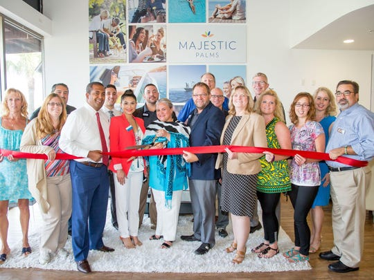 Several of the Greater Fort Myers Chamber of Commerce representatives and members recently joined the sales team of Majestic Palms Condominiums for a special ribbon-cutting ceremony.