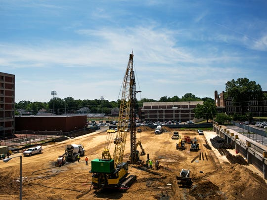 May 13, 2016 - Construction workers labor on a 700-vehicle parking area at Methodist University Hospital. The garage is part of Methodist LeBonheur Health Care's $480 million expansion in the Memphis Medical District.  (Yalonda M. James/The Commercial Appeal)