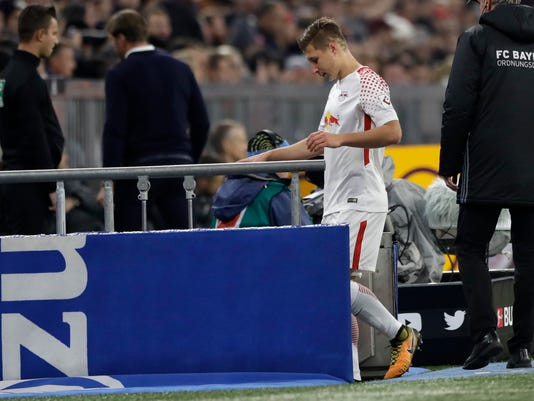Leipzig's captain Willi Orban leaves the pitch after receiving a red card during the German Soccer Bundesliga match between FC Bayern Munich and RB Leipzig in Munich, Germany, Saturday, Oct. 28, 2017. (AP Photo/Matthias Schrader)