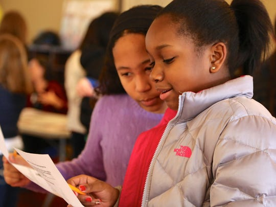 """Kent Place sixth-graders Jade Heningburg of West Orange and Samara Grannum of Watchung at the school's """"Homeless and Hunger Awareness Fair,"""" conducted on Jan. 19 as part of a Martin Luther King, Jr. Day of Service event."""