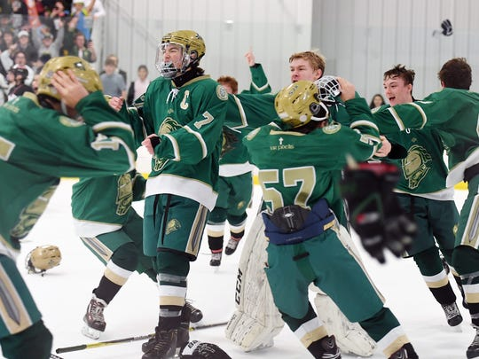 Northern Highlands vs. St. Joe's in the Big North Cup Finals at the Ice Vault in Wayne on Friday, February 16, 2018. SJ celebrates defeating NH.
